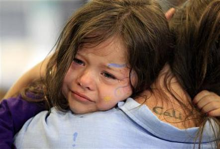Cali Farmer, 4, (L) cries as she hugs her mother Netta Farmer at California Institute for Women state prison in Chino, California May 5, 2012. REUTERS/Lucy Nicholson