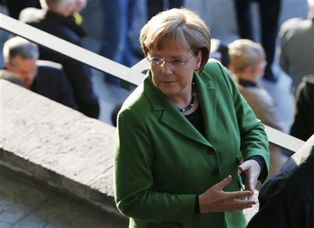 German Chancellor Angela Merkel arrives for the German DFB Cup (DFB Pokal) final soccer match between Borussia Dortmund and Bayern Munich at the Olympic stadium in Berlin, May 12, 2012. REUTERS/Fabrizio Bensch
