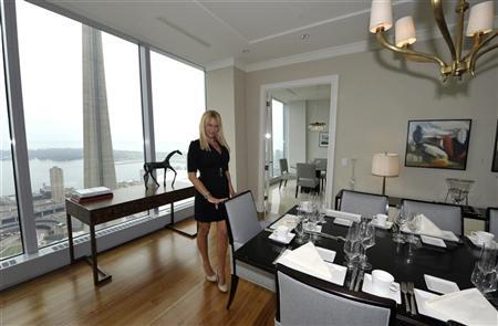 Sales Manager Jacqueline Yaffe poses in the dining room of the Ritz Carlton residents model suite in Toronto May 1, 2012. REUTERS/ Mike Cassese