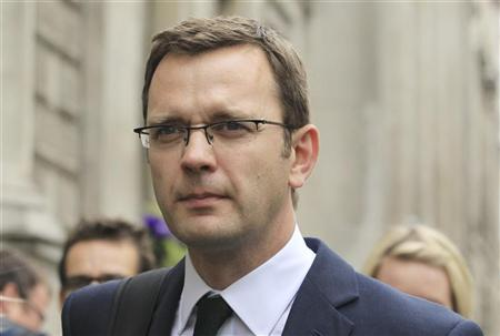 Andy Coulson, former editor of the News of the World and Former spokesman for Britian's Prime Minister David Cameron, leaves after giving evidence before the Leveson Inquiry into the ethics and practices of the media at the High Court in central London May 10, 2012. REUTERS/Olivia Harris