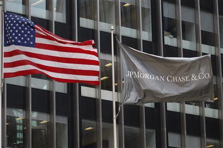 The U.S. (L) and JP Morgan flags wave outside the JP Morgan headquarters in New York May 11, 2012. REUTERS/Eduardo Munoz