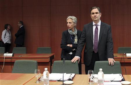 Greece's Finance Minister Filippos Sachinidis (R) awaits the start of an eurozone finance ministers meeting at the EU Council in Brussels May 14, 2012. REUTERS/Francois Lenoir