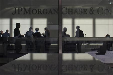The lobby of JP Morgan headquarters is photographed through it's front doors in New York. REUTERS/Eduardo Munoz