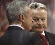 Washington Capitals head coach Dale Hunter (R) confers with assistant coach Jim Johnson during a time out against the Winnipeg Jets during the third period of their NHL hockey game in Washington March 23, 2012. REUTERS/Gary Cameron