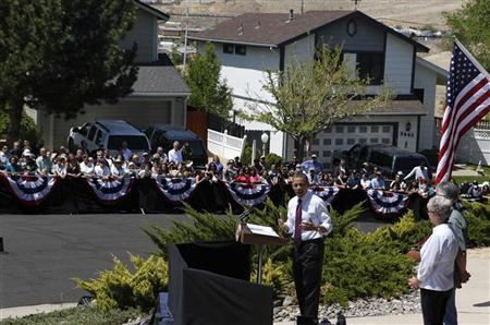 President Barack Obama speaks to the neighbors after meeting with homeowners Val and Paul Keller to discuss the housing crisis in Nevada at their Clear Acre neighborhood home in Reno, Nevada, May 11, 2012. REUTERS/Larry Downing