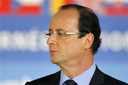 Newly-elected French President Francois Hollande attends a ceremony at the Luxembourg Gardens to mark the abolition of slavery and to pay tribute to the victims of the slave trade in Paris May 10, 2012. REUTERS/Charles Platiau