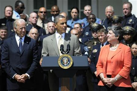 U.S. President Barack Obama (C) stands with Vice President Joe Biden (L) and Homeland Security Secretary Janet Napolitano (R) to honor the 2012 National Association of Police Organizations Top Cops award winners during a ceremony in the Rose Garden at the White House in Washington, May 12, 2012. REUTERS/Jonathan Ernst
