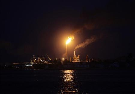 Fire burns from a chimney in the 'Nico Perez' oil refinery across the bay of Havana April 11, 2012. REUTERS/Desmond Boylan