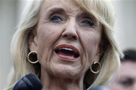 Arizona Governor Jan Brewer speaks to the press outside the U.S. Supreme Court in Washington, April 25, 2012, following arguments in the Arizona vs United States immigration enforcement law case. REUTERS/Jason Reed