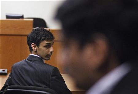 Dharun Ravi, a former Rutgers University student charged with bias intimidation, looks back at family members after hearing the verdict in his trial at the Superior Court of New Jersey in Middlesex County, New Brunswick, New Jersey March 16, 2012. REUTERS/Lucas Jackson