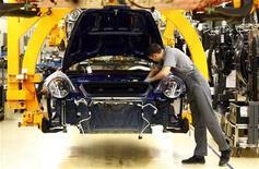 A worker assembles the new Porsche 911 sports car at the Porsche factory in Stuttgart-Zuffenhausen January 24, 2012. REUTERS/Michael Dalder