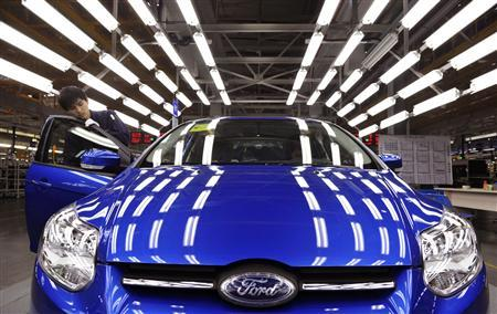 An employee works at an assembly line at a Ford manufacturing plant in Chongqing municipality April 20, 2012. REUTERS/Stringer