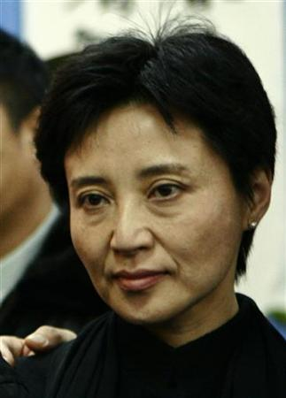 Gu Kailai, wife of China's former Chongqing Municipality Communist Party Secretary Bo Xilai (not pictured), poses for a group photo at a mourning held for her father-in-law Bo Yibo, former vice-chairman of the Central Advisory Commission of the Communist Party of China, in Beijing in this January 17, 2007 file photo. REUTERS/Stringer/Files