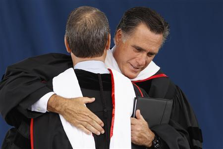 Mitt Romney, U.S. Republican presidential candidate and former Massachusetts governor, hugs evangelical advisor Mark DeMoss after being introduced to speak at Liberty University commencement ceremony in Lynchburg, Virginia May 12, 2012. REUTERS/Kevin Lamarque