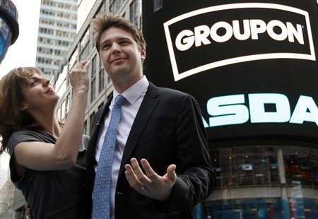 Groupon CEO Andrew Mason poses with his newly married wife, pop musician Jenny Gillespie, outside the Nasdaq Market following his company's IPO in New York in this file photo taken November 4, 2011. REUTERS/Brendan McDermid/Files
