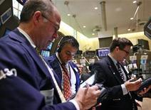 Traders work on the floor of the New York Stock Exchange May 7, 2012. REUTERS/Brendan McDermid