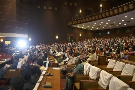 Nepalese lawmakers raise their hands agreeing to extend the term of parliament in Kathmandu May 28, 2011. REUTERS/Navesh Chitrakar/Files