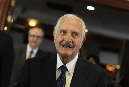 Mexican writer Carlos Fuentes arrives at a news conference announcing the Formentor Prize for Literature 2012 in Mexico City March 12, 2012. REUTERS/Tomas Bravo