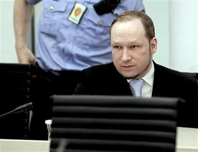 Norwegian mass killer Anders Behring Breivik takes his seat in the courtroom in Oslo May 15, 2012. REUTERS/Stian Lysberg Solum/NTB Scanpix/Pool
