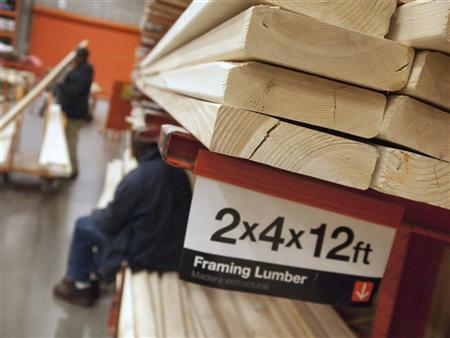 Customers shop for lumber at a Home Depot store in Washington February 20, 2012. REUTERS/Jonathan Ernst