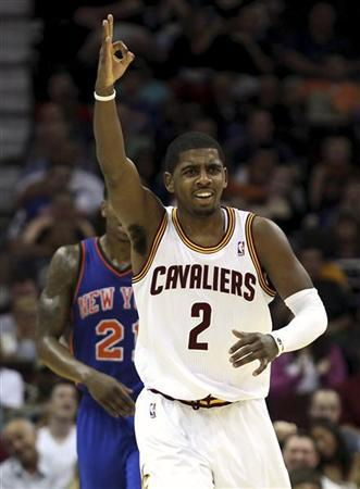 Cleveland Cavaliers' Kyrie Irving (2) signals for three after his teammate Manny Harris (not pictured) hit a three-point shot during the second quarter of their NBA basketball game in Cleveland April 20, 2012. REUTERS/Aaron Josefczyk
