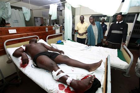 A man, injured in a suspected grenade attack, lies on a hospital bed as he receives treatment at the Coast General Hospital in the Kenyan coastal city of Mombasa May 15, 2012. REUTERS-Joseph Okanga