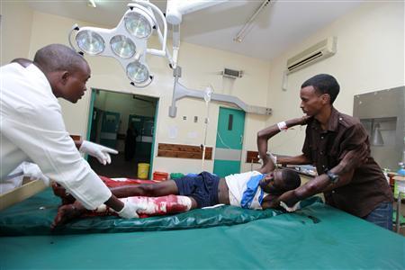 A man, injured in a suspected grenade attack, receives treatment at the Coast General Hospital in the Kenyan coastal city of Mombasa May 15, 2012. REUTERS-Joseph Okanga