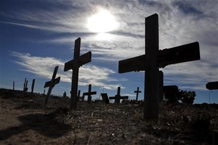 Crosses fill a graveyard in Cape Town's Khayelitsha township February 27, 2010. Many of those buried in the cemetery died from AIDS or related complications such as tuberculosis (TB). REUTERS/Finbarr O'Reilly