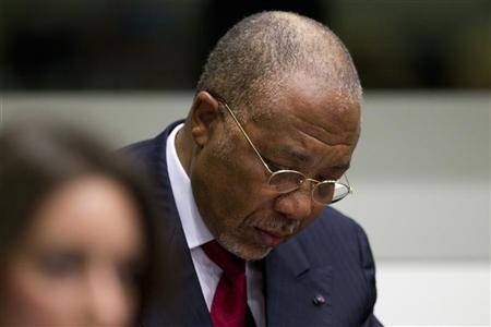 Former Liberian President Charles Taylor looks down as he waits for the start of a hearing to receive a verdict in the court room of the Special Court for Sierra Leone in Leidschendam, near The Hague, April 26, 2012. REUTERS/Peter Dejong/Pool
