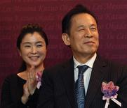 Japanese billionaire Kazuo Okada and wife Takako Okada attend the opening ceremony of a dining complex in Hong Kong May 15, 2012. REUTERS/Bobby Yip