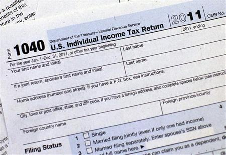A 2011 U.S. Individual Income Tax Return form is seen in New York April 17, 2012. April 17 is the deadline for U.S. taxpayers to file their individual income tax returns and pay their taxes for the 2011 calendar year. REUTERS/Shannon Stapleton