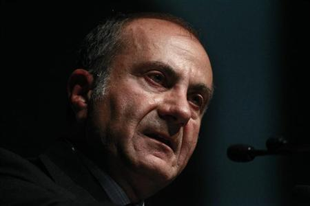 BHP Billiton Chairman Nasser speaks at a business luncheon in Melbourne in this May 9, 2011 file photo. REUTERS/Mick Tsikas