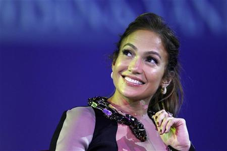 Jennifer Lopez smiles during a news conference to announce her summer tour in Los Angeles, California April 30, 2012. REUTERS/Mario Anzuoni