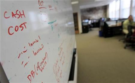 A white board is seen covered with writing at the Tradeworx office in Red Bank, New Jersey November 17, 2009. REUTERS/Mike Segar