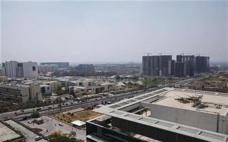 An elevated view shows a newly-built highway and the Gachibowli district in Hyderabad March 6, 2011. REUTERS/Vivek Prakash/Files