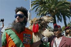 """British actor Sacha Baron Cohen walks on the Croisette during a photocall for his latest movie """"The Dictator"""" in Cannes May 16, 2012. REUTERS/Jean-Paul Pelissier"""