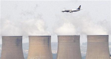 A Ryanair aircraft is seen flying above Ratcliffe Power Station as it comes into land at East Midlands Airport, central England in this July 1, 2008 file photograph. REUTERS/Darren Staples/Files