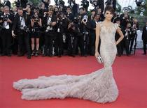 "Actress Eva Longoria arrives on the red carpet for the screening of the film ""Moonrise Kingdom"", by director Wes Anderson, in competition at the 65th Cannes Film Festival May 16, 2012. REUTERS/Eric Gaillard"