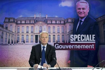 France's Prime Minister Jean-Marc Ayrault takes part in the broadcast news of French TV channel France 2 on May 16, 2012 in Paris. REUTERS/Bertrand Langlois/Pool