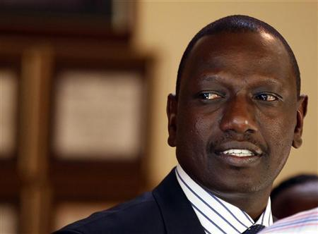 Former Kenyan Cabinet Minister William Ruto stands inside his house after hearing the news from the International Criminal Court, in Nairobi January 23, 2012. REUTERS/Goran Tomasevic