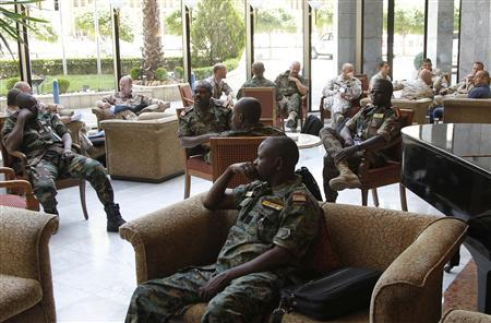 Members of the United Nations observers mission in Syria wait at a hotel lobby in Damascus, before heading to areas where protests against the regime of Syrian President Bashar al-Assad have been taking place, May 16, 2012. REUTERS/Khaled al-Hariri