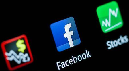 A Facebook application logo is pictured on a mobile phone in this photo illustration taken in Lavigny May 16, 2012. Facebook Inc increased the size of its initial public offering by almost 25 percent, and could raise as much as $16 billion as strong investor demand for a share of the No.1 social network trumps debate about its long-term potential to make money. Facebook, founded eight years ago by Mark Zuckerberg in a Harvard dorm room, said on Wednesday it will add about 84 million shares to its IPO, floating about 421 million shares in an offering expected to be priced on Thursday REUTERS/Valentin Flauraud