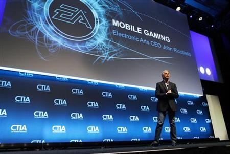 John Riccitiello, CEO of Electronic Arts, addresses attendees during the International CTIA WIRELESS Conference & Exposition in New Orleans, Louisiana May 9, 2012. REUTERS/Sean Gardner
