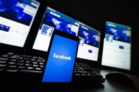 The loading screen of the Facebook application on a mobile phone is seen in this photo illustration taken in Lavigny May 16, 2012. Facebook Inc increased the size of its initial public offering by almost 25 percent, and could raise as much as $16 billion as strong investor demand for a share of the No.1 social network trumps debate about its long-term potential to make money. Facebook, founded eight years ago by Mark Zuckerberg in a Harvard dorm room, said on Wednesday it will add about 84 million shares to its IPO, floating about 421 million shares in an offering expected to be priced on Thursday. REUTERS/Valentin Flauraud