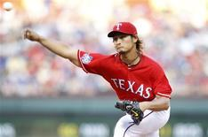 Texas Rangers starting pitcher Yu Darvish pitches against the Oakland Athletics in the second inning of their MLB American League baseball game in Arlington, Texas May 16, 2012. REUTERS/Mike Stone