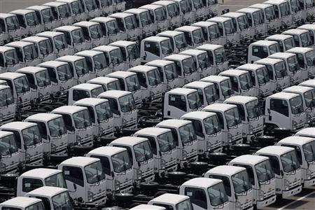 Newly produced trucks are seen at an industrial port before they are loaded to a cargo ship in Yokohama, south of Tokyo May 17, 2012. REUTERS/Kim Kyung-Hoon