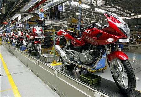 Newly built motorbikes are seen at the Bajaj Auto Ltd. plant in Pune, about 130 km (82 miles) from Mumbai August 9, 2007. REUTERS/Punit Paranjpe/Files