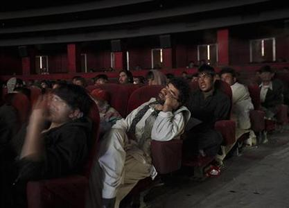 A cinema goer sleeps as others watch a Bollywood film at Ariana Cinema in Kabul May 3, 2012. REUTERS/Danish Siddiqui