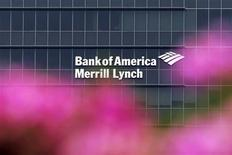A Bank of America Merrill Lynch sign is seen on a building that houses its offices in Singapore May 17, 2012. Royal Bank of Canada and Credit Suisse are among the suitors seeking to bid for the non-U.S. wealth management businesses of Bank of America Merrill Lynch, sources told Reuters, in a deal that could be worth around $2 billion. REUTERS/Tim Chong