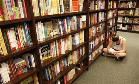 A girl reads in an aisle at a Barnes and Noble bookstore in a town in Virginia, August 24, 2010. REUTERS/Kevin Lamarque